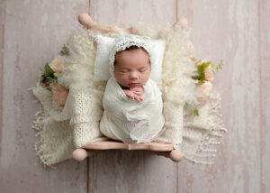 newborn baby girl wrapped