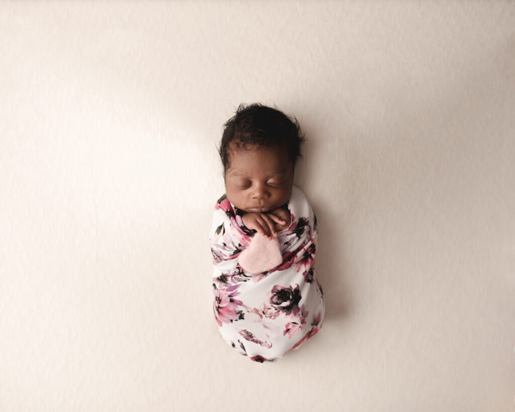 sleepy newborn rocking photo shoot